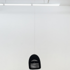 Artie Vierkant, Ikea Office Chair Back Suspended from Metal Wire (possible object), 2012 IKEA Vilgot, IKEA Dignitet, screws, 2012, dimensions variable