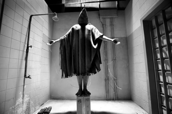 Hooded Prisoner on a Box- Reenactment