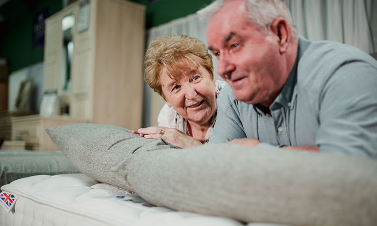Eldery Couple laying on Combination Mattress