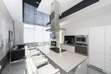 Fully equipped kitchen, island with cooking top.