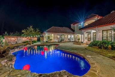 Stunning pool area with string lights. The perfect place to hang out, party,...