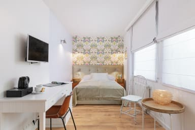 The heart of the room is a large, double bed with a comfortable mattress that...
