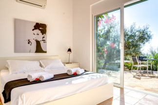 Beautifully arranged bedroom 4 with relaxing view