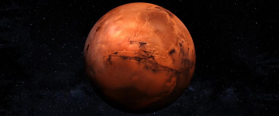 A red planet in space  Description automatically generated