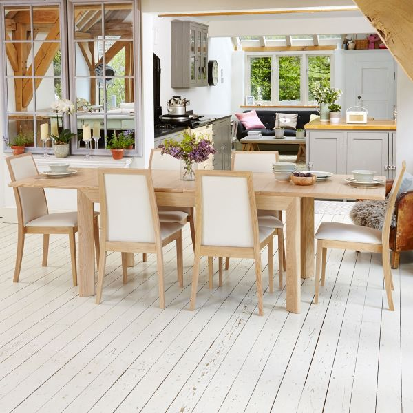 Olten Light Oak extending table and 8 cream dining chairs