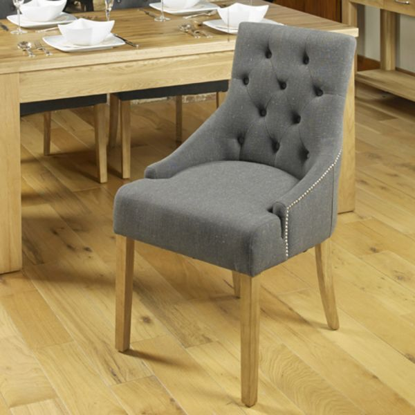 Two grey flock dining chairs with arms