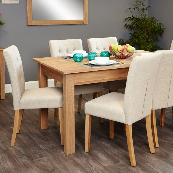 Mobel Oak 4-6 seat table and 6 cream chairs