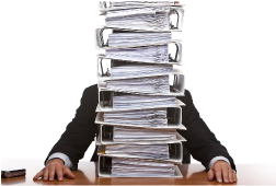 Man sat behind a stack of files