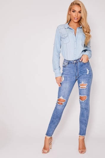 ZANEY BLUE LIGHT WASH DENIM HIGH WAISTED MULTI RIP FRAYED HEM SKINNY JEANS
