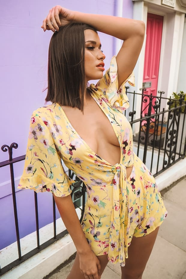 BRYANIE YELLOW FLORAL PLUNGE TIE FRONT PLAYSUIT