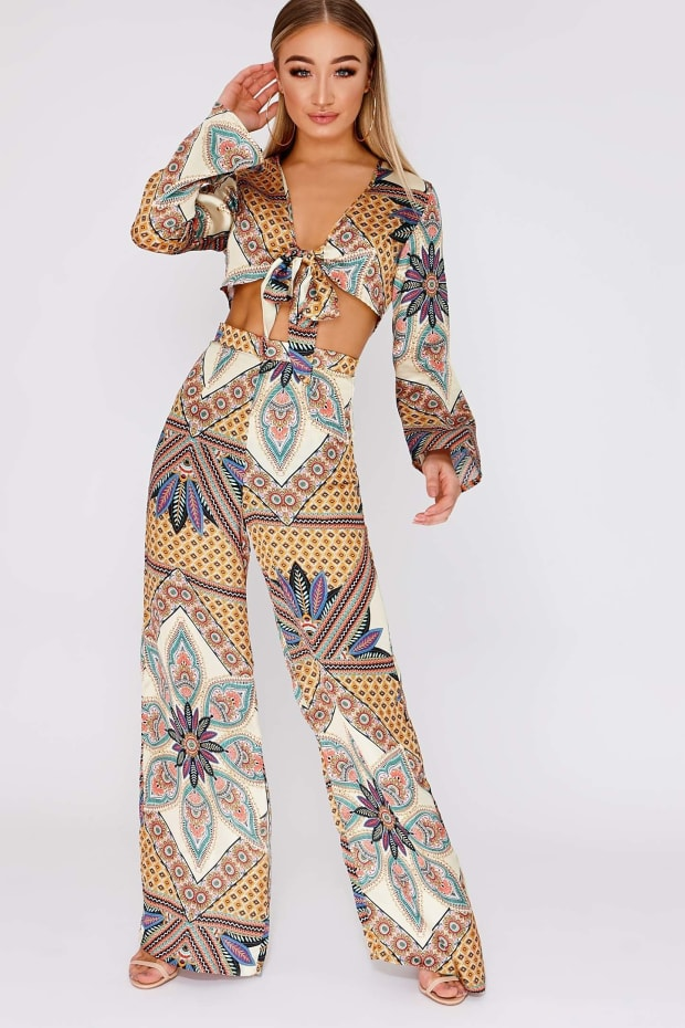KAMELLA MUSTARD TROPICAL PRINT SATIN SIDE SPLIT TROUSERS
