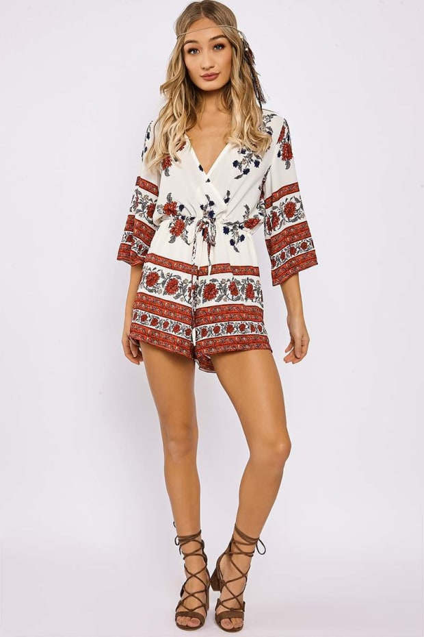 TIRZAH CREAM FLORAL BORDER PRINT PLUNGE PLAYSUIT