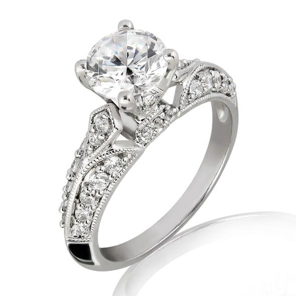 แหวนทอง 18K ประดับเพชร น้ำหนักรวม 0.70 กะรัต ค่าสี E ค่าความสะอาด VS2 เพชรมาพร้อมใบรับรองจาก GIA