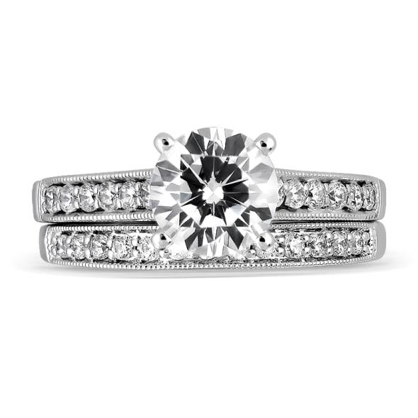 แหวนทอง 18K ประดับเพชร น้ำหนักรวม 0.74 กะรัต ค่าสี D ค่าความสะอาด VVS1 EX/EX/EX เพชรมาพร้อมใบรับรองจากสถาบัน GIA และแหวนเพชร Matching Band