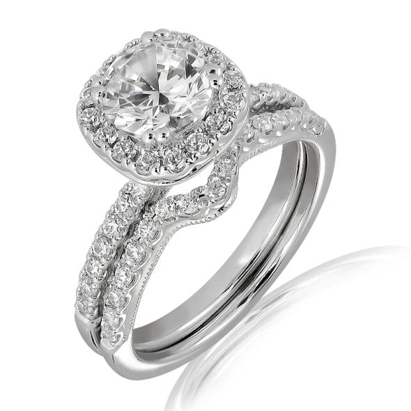 แหวนทอง 18K ประดับเพชร น้ำหนักรวม 0.97 กะรัต ค่าสี D ค่าความสะอาด VVS1 EX/EX/EX เพชรมาพร้อมใบรับรองจากสถาบัน GIA และแหวนเพชร Matching Band