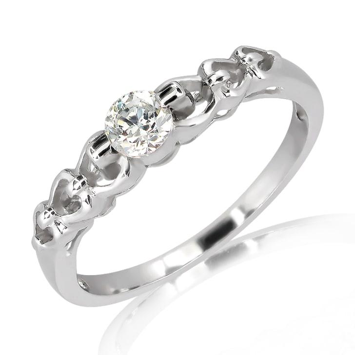 แหวนทอง 18K ประดับเพชร น้ำหนักรวม 0.20 กะรัต ค่าสี E ค่าความสะอาด VS