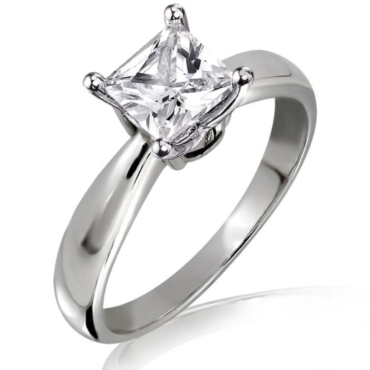แหวนทอง 18K ประดับเพชร น้ำหนักรวม 0.74 กะรัต ค่าสี G ค่าความสะอาด VS2 เพชรมาพร้อมใบรับรองจากสถาบัน IGL