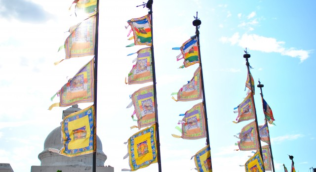 Flags fly high at the temple complex of Boudhanath in Nepal, Asia