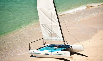 a boat sitting on top of a sandy beach