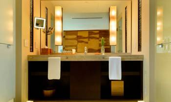 a hotel room with a sink and a mirror