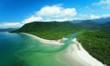a body of water with Cape Tribulation, Queensland in the background