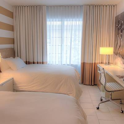 a bedroom with a bed in a hotel room