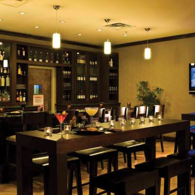 a room filled with furniture and a flat screen tv sitting in a restaurant