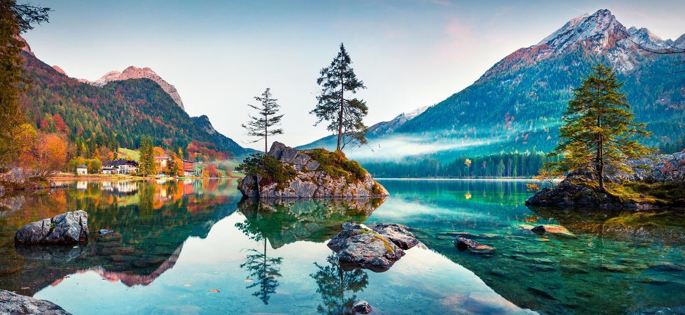 Enchanting Travels Germany Tours Beautiful autumn scene of Hintersee lake.
