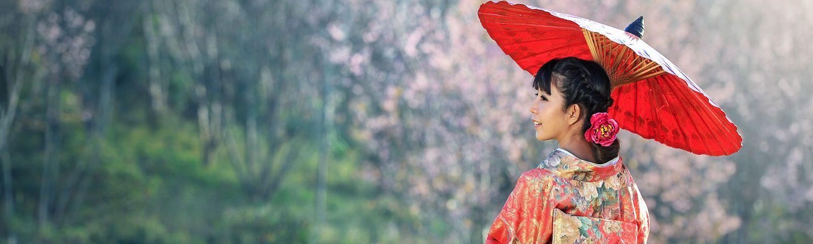 Enchanting Travels - Asian woman wearing traditional japanese kimono, sakura background - private tour of Japan