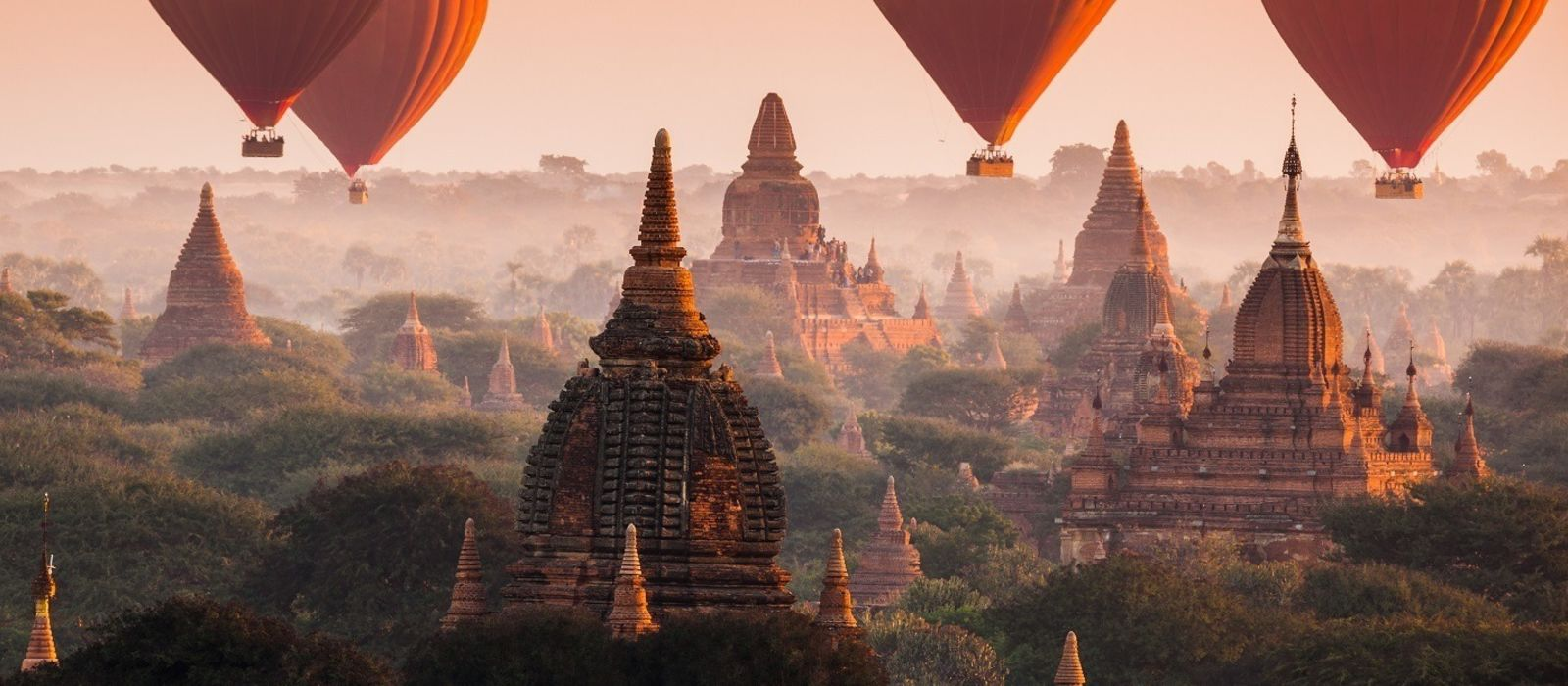 Hot air balloon over Bagan in misty morning, Myanmar, Asia