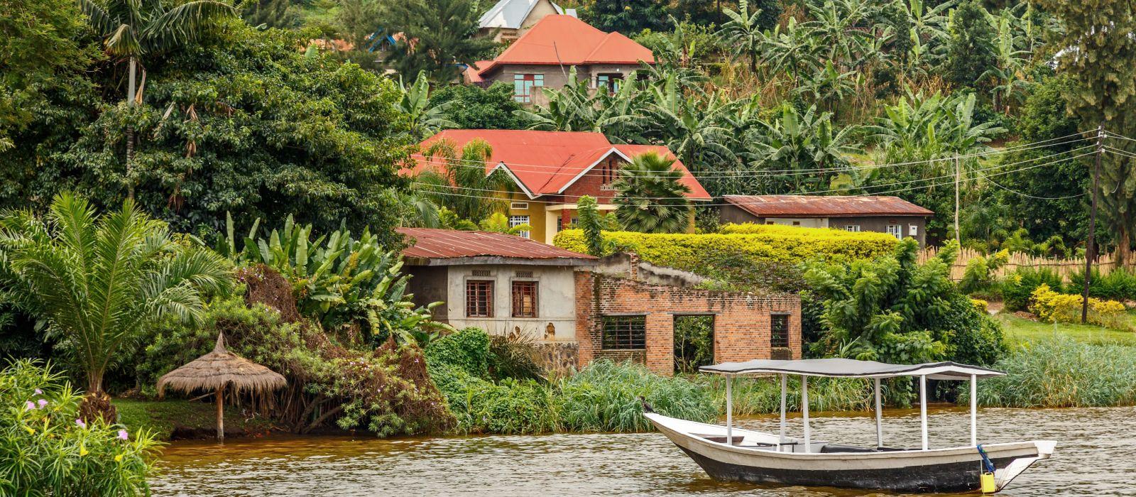 Roof boat anchored at the coast with rwandan village in the background, Kivu lake, Rwanda