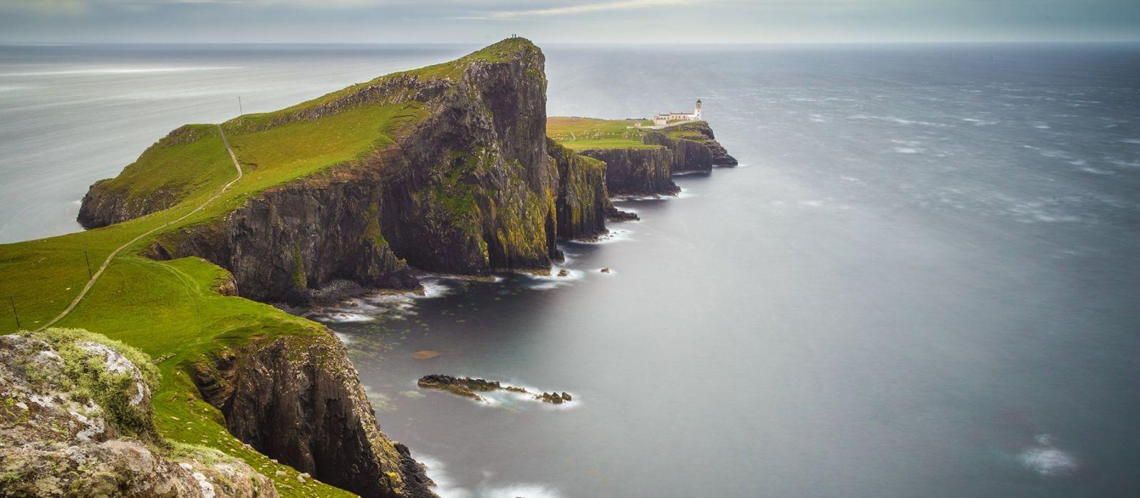 Enchanting Travels UK & Ireland Tours Neist point lighthouse on a cloudy day, Isle of Skye, Scotland, UK
