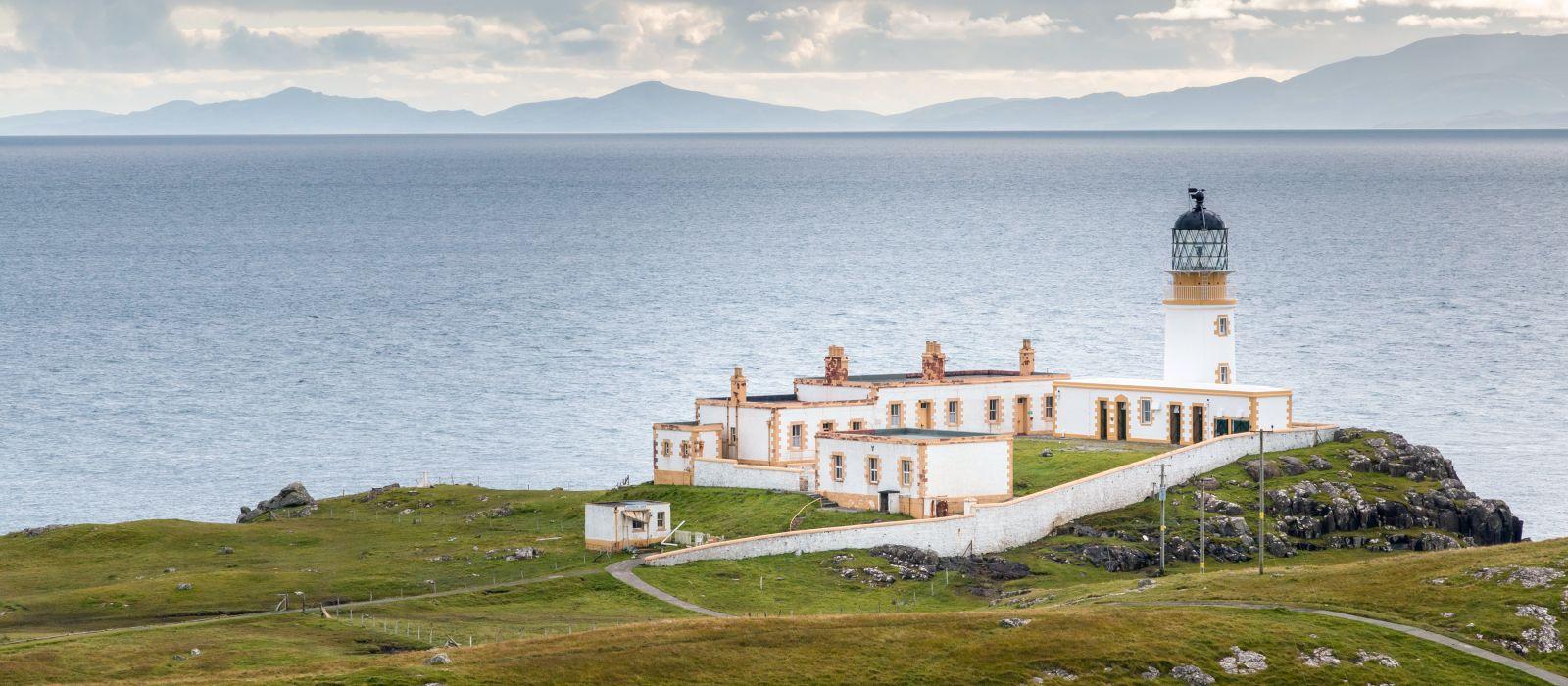 Lighthouse on the cliffs of Neist Point, a famous landmark near Glendale, Isle of Skye, Scotland, Europe