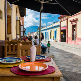Restaurant view and sidewalk on San Cristobal de las Casas colonial town. Latin American Culture