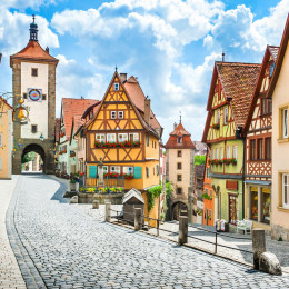 Beautiful postcard view of the famous historic town of Rothenburg ob der Tauber on a sunny day with blue sky and clouds in summer, Franconia, Bavaria, Germany best time to visit Europe