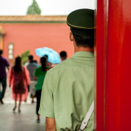 Enchanting Travels China Tours Guard standing at door entrance to the palace in China - Is China safe