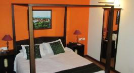 Enchanting Travels - Südindien Reisen - Cochin - Tea Bungalow - Schlafzimmer