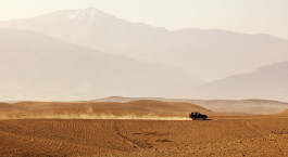 Vehicle driving through Agafay desert, Morocco