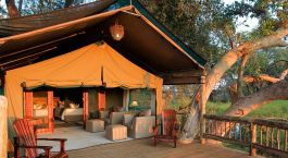 Tent porch relaxation at Gunn's Camp in Okavango Delta, Botswana