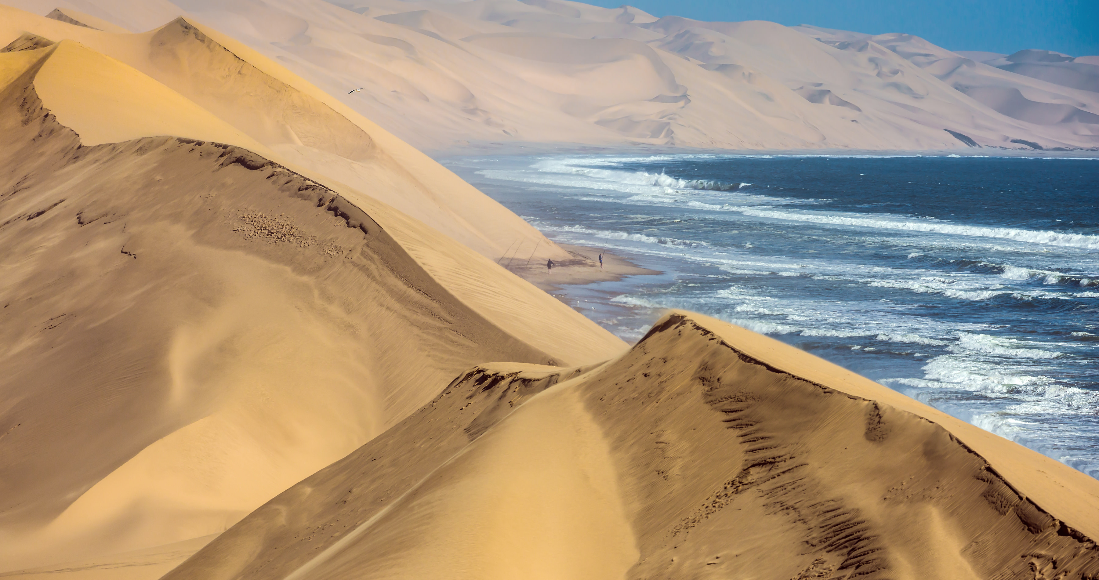 Atlantic coast of Walvis Bay, Namibia. Ocean surf with foamy waves - Namibia travel guide