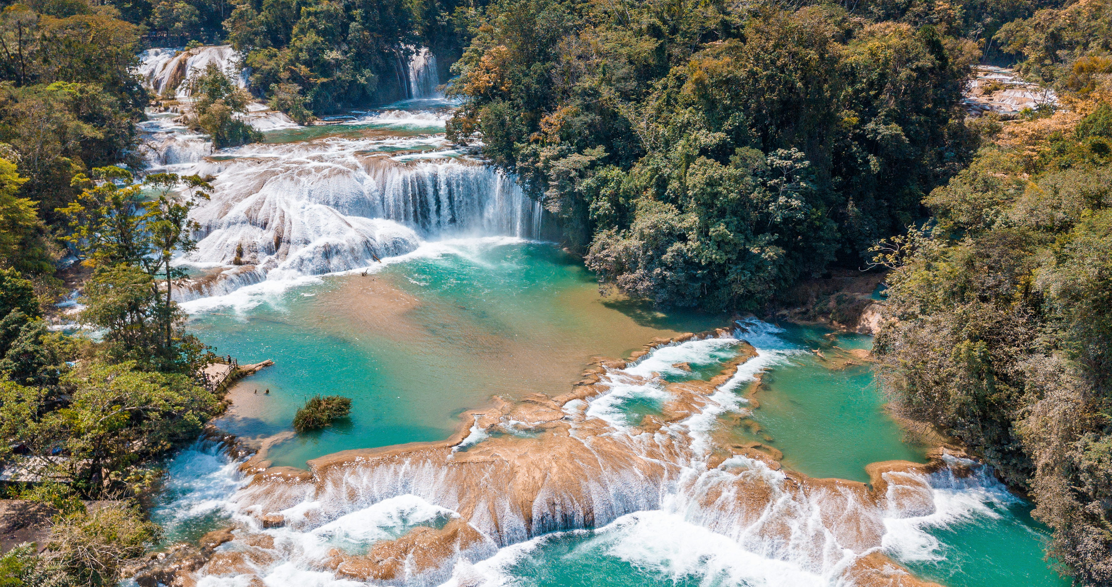 is it safe to travel to Mexico? - Aerial view of the majestic turquoise waterfalls at Agua Azul in Chiapas, Mexico, Central America