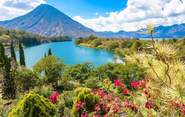 Enchanting Travels Guatemala Tours Lake Atitlan Beautiful bay of Lake Atitlan with view to Volcano San Pedro in highlands of Guatemala, Central America
