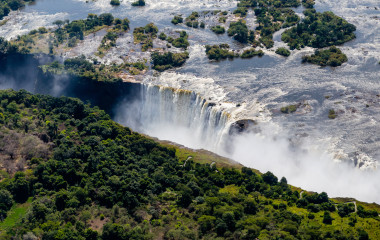 Victoria falls, surrounding area is the National Parks and World Heritage Site (aerial view) - Zambia, Zimbabwe, Africa