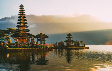 Enchanting Travels Bali Tours Pura Ulun Danu temple panorama at sunrise on a lake Bratan, Bali, Indonesia
