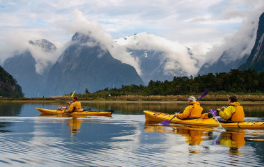 Enchanting Travels New Zealand Tours sea kayak in Milford Sound, New Zealand