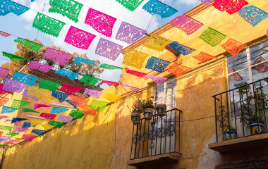 Enchanting Travels Mexico Tours Colorful paper flags over street