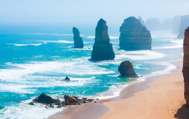 The Twelve Apostles, a famous collection of limestone stacks off the shore of the Port Campbell National Park, by the Great Ocean Road in Victoria, Australia.