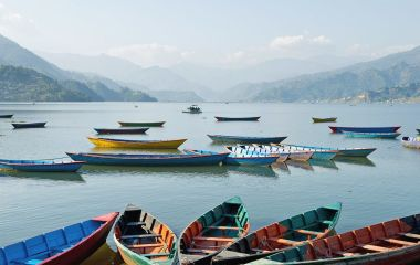 Lake with boats in Pokhara, nepal vacation