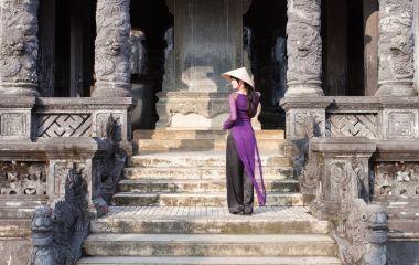 Vietnamese girl in long purple dress