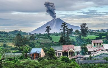 Enchanting Travels Indonesia Tours Sinubung volcano eruption at sunrise, North Sumatra
